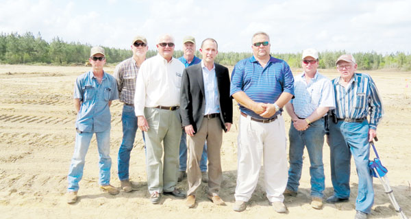 Brooks Peanut Company Officials Frank Talbot, Barrett Brooks and Lee Talbot, front row from left, are surrounded by farmers Alan Edwards, Rick Hendricks, Keith Campbell, Mickey Diamond and Glen Campbell who plan on supplying the company with peanuts for Escambia County's newest industry.