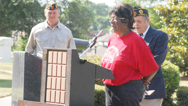 Dorothy Newton speaks about her brother, Kenneth, during a Memorial Day service at the Escambia County Courthouse Monday.