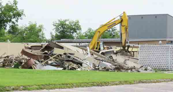 Walls cam down Monday as demolition began in the first phase of work planned on the campus at T.R. Miller High School began. Once  debris is  removed,  construction can begin.