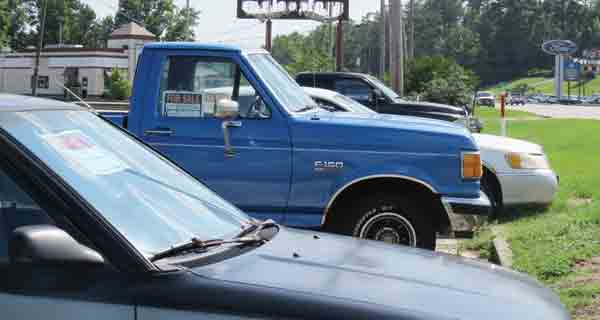 As many as a dozen vehicles have been parked in parking lots around the city on any given day — all up for sale by the owners. City officials are looking ways to curb the make-shift lots popping up for that purpose.