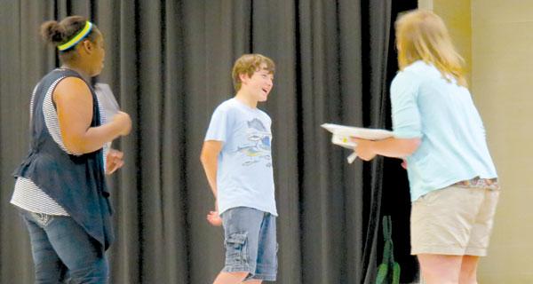 Ilynn Moss, left, and Jacob Crane take direction for Amanda Tatum at WSN Middle School's Missoula play rehearsal.