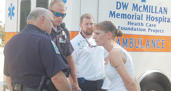 Brewton police officers talk with Rodrick after her arrest on DUI and other charges.
