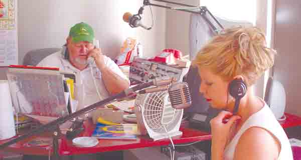 file photo | The Brewton Standard Dunaway is shown above left with co-host Candy Cashman Smith during broadcasts on WEBJ-AM following Hurricane Ivan in 2004 as the pair gave valuable information to area residents.