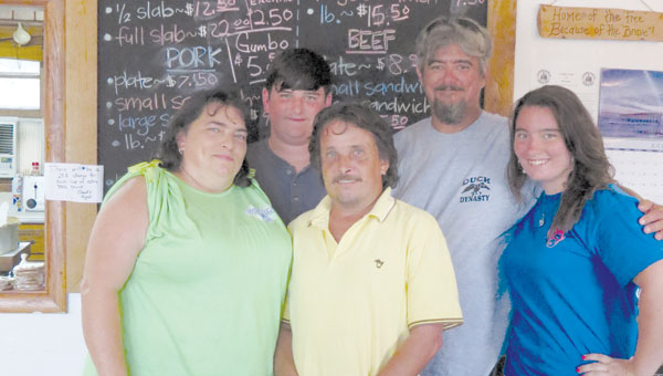 Martha and Ludon Simmons, along with other family members, have joined forces in owning and operating George's Barbecue.