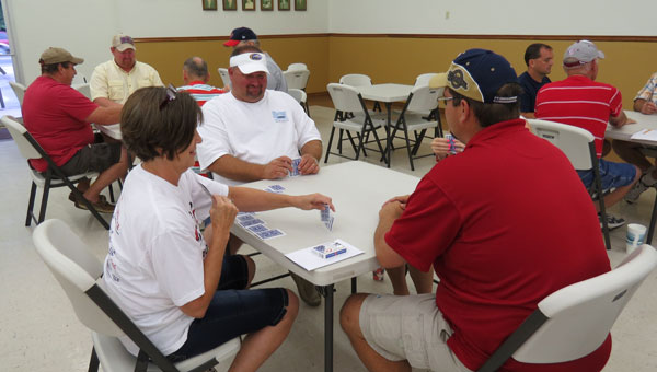 Joey Wyatt, center, and Marlin Franklin, shown facing away, were the ultimate winners in the annual July 4th Spades tournament in East Brewton.