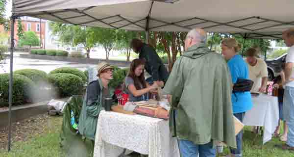 Tents and rain jackets were premium items as vendors provided cover for buyers making purchases in the rain.