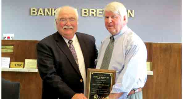 """Kelly, right, was honored Wednesday for more than 50 years in the banking industry. Wayne Lambert, left, representing the Alabama Bankers Association, presented a plaque naming Kelly to the """"Half Century Club"""" with the organization."""