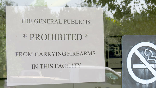 Signs like this one posted at Brewton City Hall will become a common site at city and county facilities.