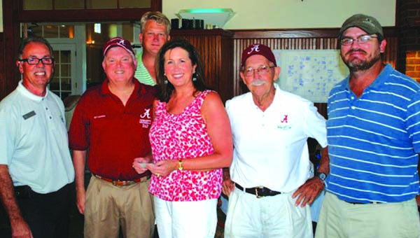 Special to the Standard First place winners in the Walter Lewis golf tournament Thursday was the Bank of Brewton team. From left, Don Ward, Russell Smith, Dr. Bob Hayes and Kevin Terrell. Also in photo are, far left, Don Beardsley, manager of the Country Club of Brewton and middle, Miriam McDaniel, President of the Escambia County University of Alabama Alumni and Friends.