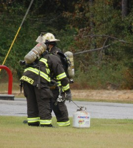 Firefighters test for a leak.
