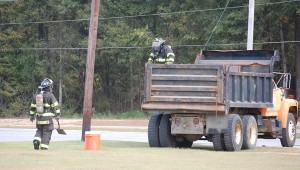 The tank was loaded onto a dump truck lined with sand.