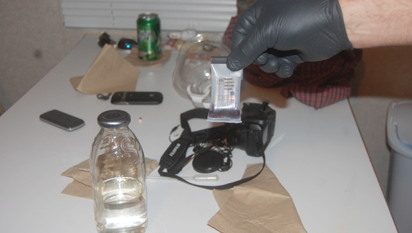 A bottle of clear liquid found at the scene of a suspected meth lab tested positive for meth Monday night, authorities said.