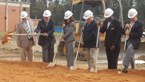 School system and school board officials toss some dirt for the official groundbreaking for the new W.S. Neal High School in East Brewton.