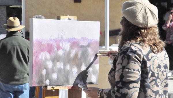 Faith Williston paints at Thou Art during Black Friday sales.
