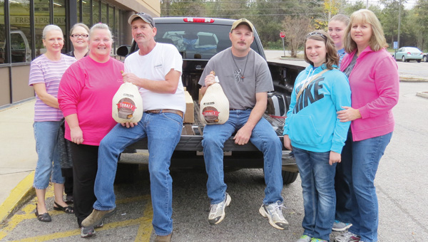 Volunteers with the Healting of the Souls ministry, above, were up working erly Saturday gathering turkeys to deliver to those in need this holiday season. Shown making the pickup were, from left, Beverly Blair, Tonya Thompson, Janet Byrd, Chris Byrd, Jeff Gunn, Olivia Britt, Jenna Britt and Lori Britt.
