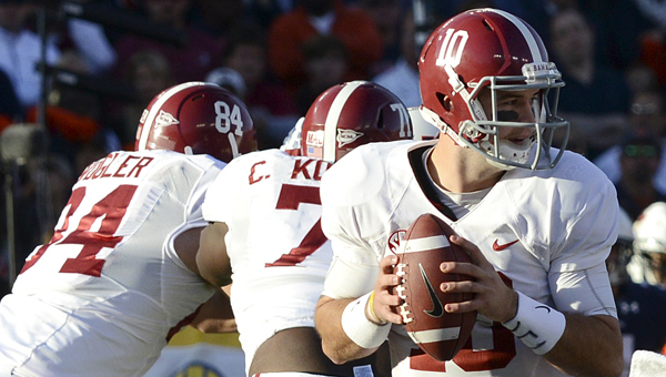 Alabama quarterback A.J. McCarron was named a finalist for the Heisman trophy, along with Tre Mason of Auburn. (Photo by Jay Sowers, The Selma Times-Journal)