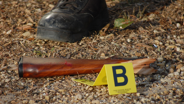 The broken handle of a rifle was among the pieces of evidence collected at the scene of a shooting Thursday afternoon.