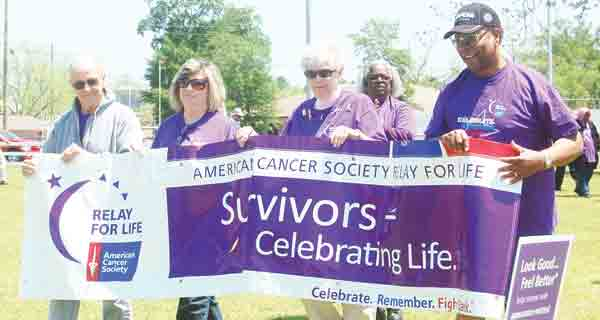 Survivors from last year's event, shown, take the first lap in the annual Relay for Life Event. The 2014 event will begin with opening ceremonies at noon followed by the Survivor's Lap.