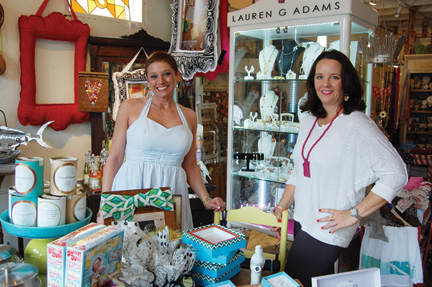 Tracey Miller and Emmie Jernigan pose inside Thou Art. Jernigan has sold the business to Miller.