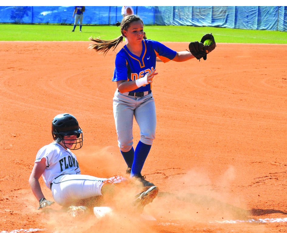 Adam Robinson | The Brewton Standard W.S. Neal's Karissa Johnson fields a throw at third base while a Flomaton player slides in safely.