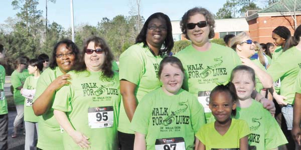 Stephanie Nelson | The Brewton Standard Abby Madden, Katie Maddox and Raven Jones –- and their family and friends – at the benefit walk for Luke Isacson Saturday. For more photos of the day's event, see the Wed., April 2, 2014, print edition.