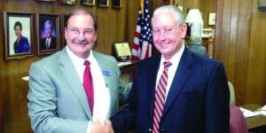 Current county school superintendent Randall Little (right) congratulates John Knott (left) on his new post.