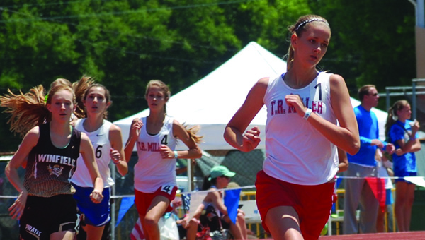 TRM's Karisa Nelson, front right, broke three records at the state meet. Photo from Josh Bean   al.com