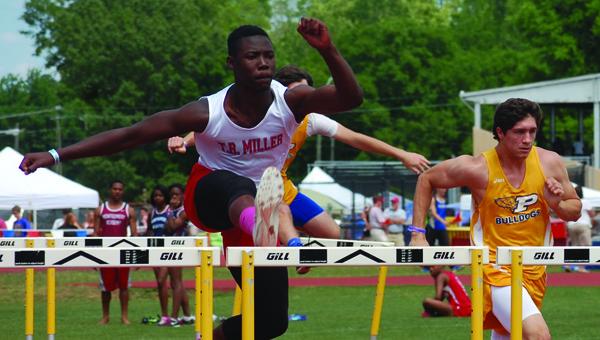 Ahmuad Taylor runs the hurdles | Photo from Josh Bean al.com