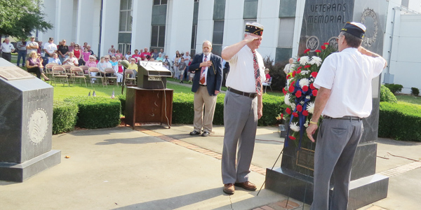 Lydia Grimes | The Brewton Standard The occasion was solemn Monday as residents gathered on the courthouse lawn to honor the sacrifices of our military. Among those honored was Leonard L. Peevy for his 60 years of continuous service to the American Legion.