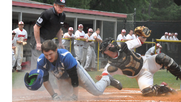 JDCC Warhawk baseball catcher Alex Jones makes a play at the plate against ASCC earlier in the season in Brewton. ASCC ended JDCC's season Tuesday at state with an 11-0 win. JDCC finished fourth in the state.
