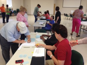 Poll workers assist voters at Brewton City Hall Tuesday.
