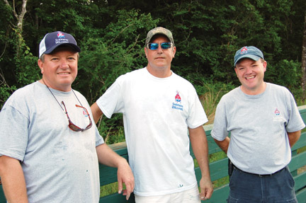 Brown, center, is pictured with David Wilson and Robbie McClelland of Sherwin Williams at the project site.