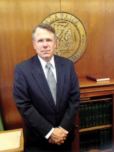 Circuit Judge Bradley E. Byrne poses inside his office. He will retire at the end of the month.