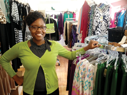 Janova Johnson of The Modest Closet stands among her inventory Monday. The store will hold a grand opening on Saturday at 9 a.m.