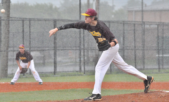 Andrew Etheridge pitches for Arizona State against South Carolina Monday in the rain. The game was called with USC leading ASU 1-0 in the top of the first inning.