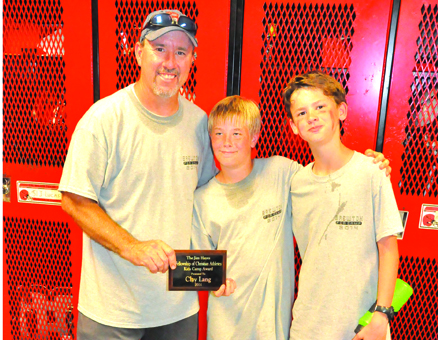 Clay Lang, middle, received the Jim Hayes award from camp director Randy Winton and 2013 winner Rider Jernigan.
