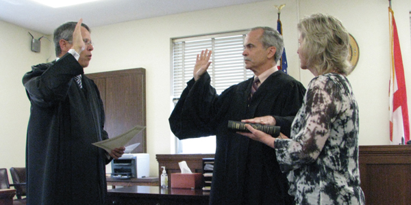 Circuit Judge Bradley Byrne, who retired on Tuesday, swears in newly-appointed district judge Dave Jordan.