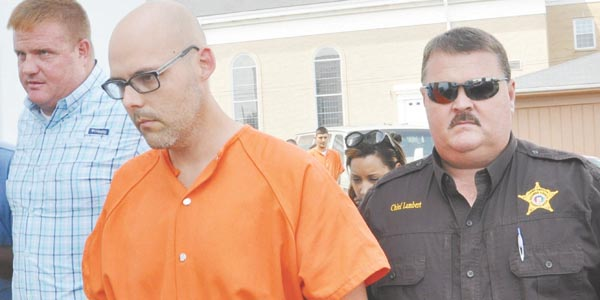 Stephanie Nelson | Brewton Standard Jeffrey Lance Gainous is escorted by Brewton Police Chief Monte McGougin (left) and Chief Deputy Mike Lambert into court Friday.