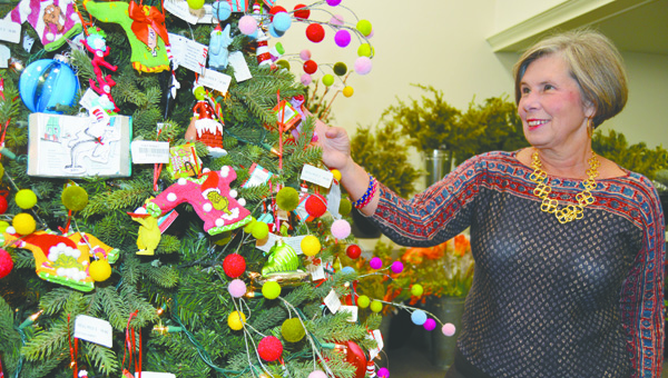 Ruth Parker eyes the decorations inside the Cracked Pot Tuesday. The store, along with others throughout Brewton, will welcome shoppers for a special event Thursday.