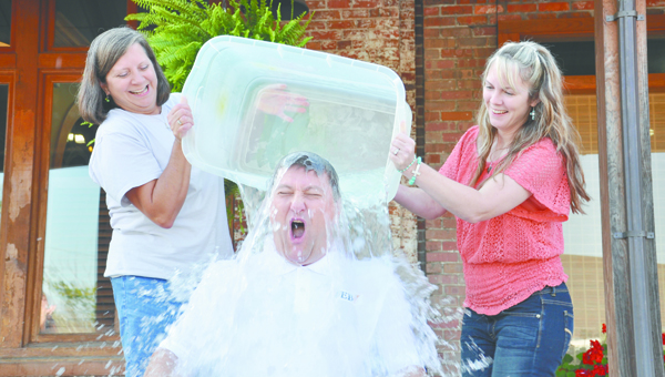 Alex McDowell, vice president at First Exchange, gets doused by Susan Reeves, branch manager, and Regina Pettis, loan review officer in August during an 'Ice Bucket Challenge.'