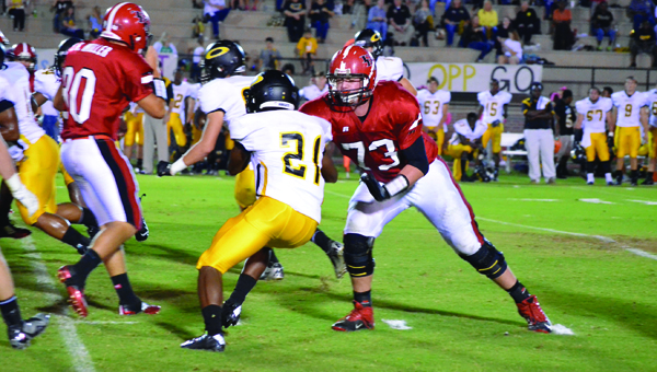 File photo | The Brewton Standard T.R. Miller's James Peach blocks against Opp in a game during the 2014 season. Peach has committed to play his college football at Southern Mississippi.