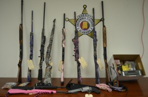 Twelve firearms and an assortment of items were recovered from the Waldrop home.