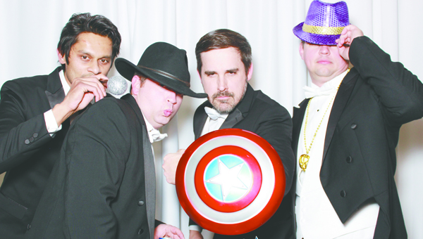 Photo of Pensacola Photobooth Anand Patel, Wade Winstead, Andrew Clark and Mike Adams ham it up for the camera during the Wild at Heart's annual Mardi Gras ball Relay for Life fundraiser. More photos will be featured in the upcoming editon of brewton: the magazine.