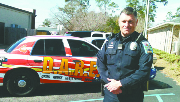 Lydia Grimes |  Brewton Standard Officer Heath Madison stands beside the DARE car.