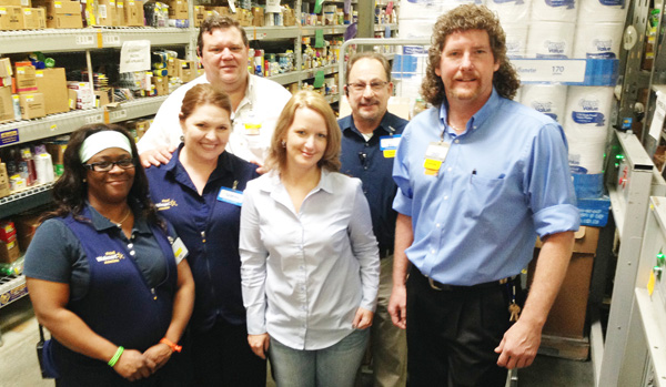 Chuck McCall, new Brewton Wal-Mart manager, poses with store employees, Liz Robinson; Bill Bari, Belinda Brazile and Toby Gagiano. McCall was a contestant on the 22nd season of the CBS hit show, The Amazing Race. He has been with Wal-Mart for 14 years and was recently transferred from Daphne.
