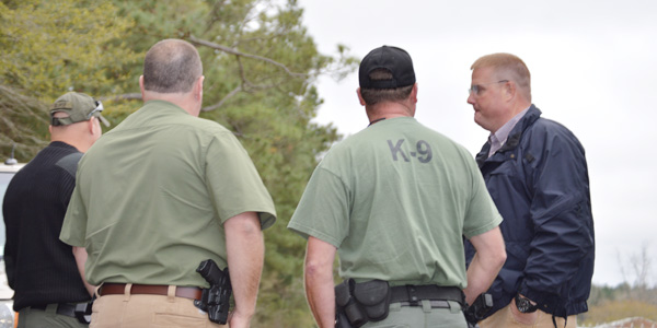 Law enforcement – including K-9 officers from two states – work to coordinate the search for Donnie Turner Friday morning near Riddle Road.