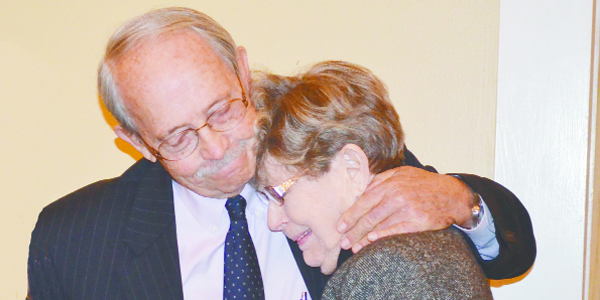 Dr. and Mrs. Hayes share a moment at the podium after the announcement.