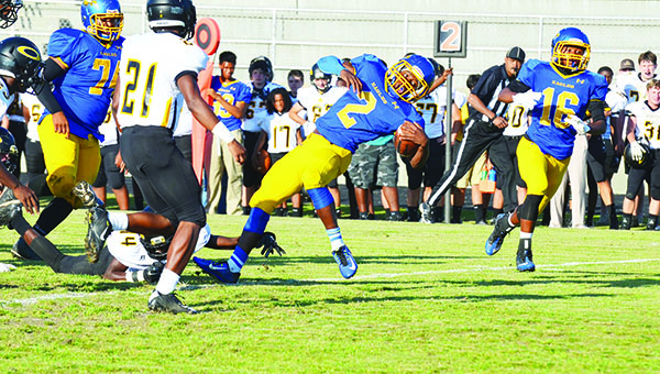 WSN's Malcolm Hawthorne fights for more yardage Friday against Opp.