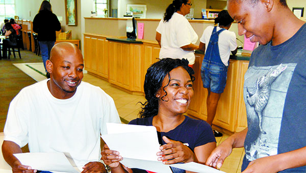 Laqueisha Travis, Willie Samuel and Rayon Jones, all of Brewton, were among the 60 actors who auditioned Saturday.