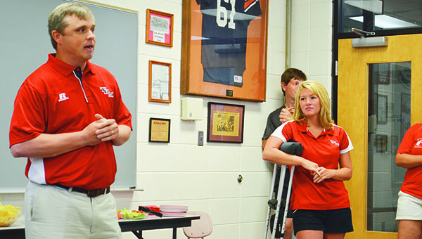 Adam Robinson | The Brewton Standard New T.R. Miller head baseball coach Kevin Madden, left, talks to those in attendance Monday evening while new TRM softball and volleyball coach Terri Lynne Peacock, far right, looks on.